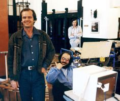 Stanley Kubrick seems to be giving a shaka while hanging out on the Lobby set of The Shining with Jack Nicholson.