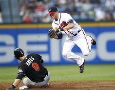 Miami Marlins' Brett Hayes (9) is forced out at second base by Atlanta Braves shortstop Tyler Pastornicky on a Ricky Nolasco bunt in the third inning of a baseball game Thursday, May 17, 2012, in Atlanta. Nolasco was safe at first. (AP Photo/John Bazemore)