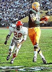 Super Bowl 1  (1967) - Max McGee of Green Bay against Kansas City. The Packers defeated the Chiefs, 35-10 at the Los Angeles Memorial Coliseum.