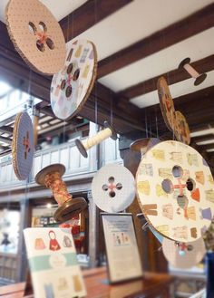 """Floating"" cardboard buttons!  A stunning decorating idea for a 'cute as a button' party!"