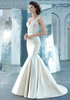 silk faced satin trumpet bridal gown, sheer jewel encrusted V-neck bodice, crystal trim at natural waist, chapel train.