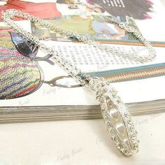 Silver Pearl pea pod necklace. Starting at $5 on Tophatter.com!