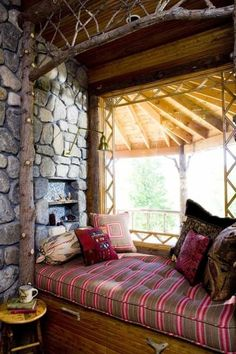 How To Design A Reading Nook For Your Home. Log design, stone wall with nook Cozy Nook, Cozy Corner, Bed Nook, Cozy Cabin, Porch Nook, Porch Bed, Home Design, Interior Design, Design Design