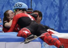 Charles Hamelin of Canada, right, embraces Marianne St. Gelais after he won the men's 1500m short track speedskating final in Sochi.