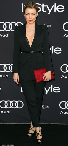 She's got the X factor! Dannii Minogue, 43, stunned in a black power suit that showcased a generous glimpse of cleavage at the InStyle Man of Style Awards on Wednesday night in Sydney