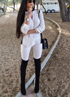 white shirts blouse leggings black high boots + shoulder bag.  women fashion outfit clothing style apparel @roressclothes closet ideas