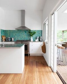 Relaxed beach house vibes in this white kitchen with turquoise herringbone tile backsplash Turquoise Kitchen, Teal Kitchen, Kitchen Paint Colors, Kitchen Modern, Grey Kitchens, Home Kitchens, Farmhouse Kitchens, Modern Farmhouse, Kitchen Interior