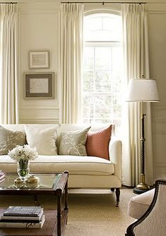 Two windows side by side with well-done pleated panels  pretty palette