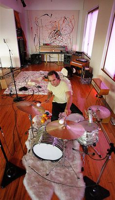 Daniel Lanois recording drums at home.