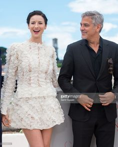 Caitriona Balfe and George Clooney attend the 'Money Monster' Photocall at the annual 69th Cannes Film Festival at Palais des Festivals on May 12, 2016 in Cannes, France.