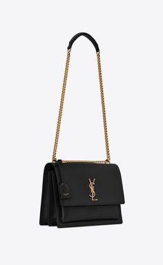 Saint Laurent monogram bag with front flap, featuring side gussets, a leather shoulder strap, leather-encased key ring and metal YSL initials. Fall Handbags, Kate Spade Handbags, Chanel Handbags, Fashion Handbags, Tote Handbags, Purses And Handbags, Fashion Bags, Cheap Handbags, Popular Handbags