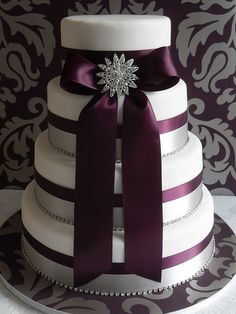 Purple ribbon wedding cake, simple yet elegant. For wedding day brooches click here: http://www.affordableelegancebridal.com/crystal-pins.html