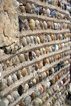 shell wall - I'd kinda like to do this outside with the shells we've collected. - Maybe not quite like this, but I like the concept.