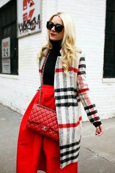 Blogger Blair Eadie of Atlantic-Pacific wearing a Tibi skirt, Calypso turtleneck, CH Carolina Herrera shoes & Chanel bag