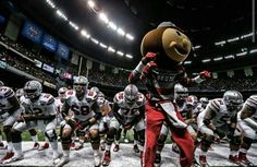 The Ohio State University Football Team / National Champions With Brutus The Buckeye