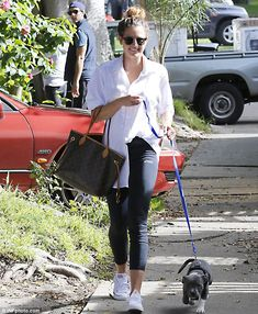 Taking a stroll: Jesinta Campbell walked through Bondi on Tuesday with her Staffordshire Terrier Axl