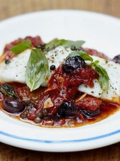 Fresh baked white fish is utterly beautiful when fresh and this recipe is incredibly tasty an versatile; served with olives and a simple tomato sauce.