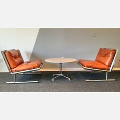 Armless Lounge Chairs - leather and chrome