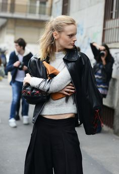 Clutch and leather jacket