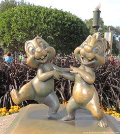 Chip 'n Dale statue in the Magic Kingdom at Disney World. ---45 great #Disney World freebies & free newsletter: http://www.buildabettermousetrip.com/disney-freebies/  #MagicKingdom #Disneyworld