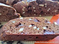Dark Chocolate Almond Biscotti low fat  Makes 2 dozen     1 cup all purpose flour  1 cup white whole wheat flour  ½ cup unsweetened cocoa powder  1 tablespoon instant espresso powder  1 ½ teaspoons baking powder  1 teaspoon cinnamon  ¼ teaspoon kosher salt  3 large eggs worth of flax mix  ½ cup packed light brown sugar  ¼ cup granulated sugar  1 ½ teaspoons vanilla  3 ounces dark chocolate (70% cacao), chopped (about ½ cup)  ½ cup slivered almonds