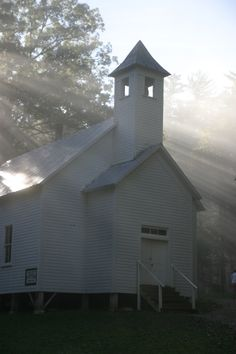 Sun rising over the Cades Cove church.