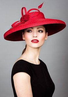 Rachel Trevor Morgan, S/S 2014. Stitched Italian straw cut through with ribbon rosette and arrow feather. #passion4hats
