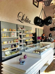 Lolita, restaurant & café in Ljubljana, Slovenia. Black cherry lamps by Nika Urbanc.