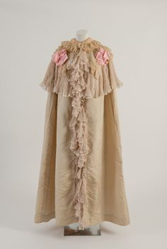 House of Worth, c 1900. Cream and pink silk opera cloak with lace and chiffon collar. Worn by Mary Chamberlain. Fashion Museum Bath.