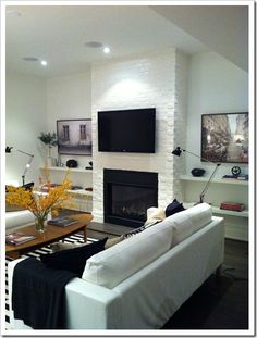 Dig the black accents because I want black leather furniture! Fake fireplace in the basement?? Might be a good idea.