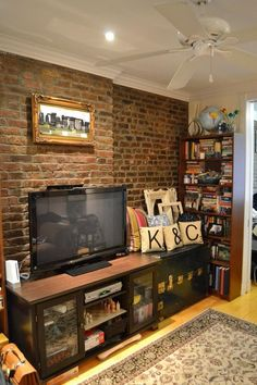 small apartment living: exposed brick. yes please!