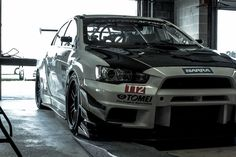 Mitsubishi EVO X beast. Modified in white. Front view