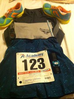 My attire for Fort Rucker's Survivors and Fallen Heroes 5K. Newton Distance running shoes, Brooks running shirt, Merida SparkleSkirt, Unite Running Team t-shirt, Garmin running watch.