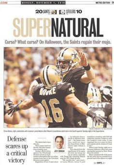 Drew Brees & Lance Moore celebrate on the front page of the New Orleans Times-Picayune on Nov. 1, 2010.