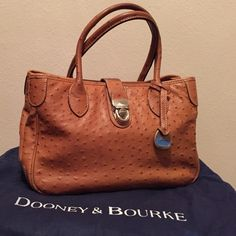 Dooney & Bourke Ostrich small tote D&B  ostrich double handle tote. Embossed calf leather and gold plated hardware with shoulder strap. Color Cognac. Like new with registration number card and proof of purchase. Dooney & Bourke Bags Totes