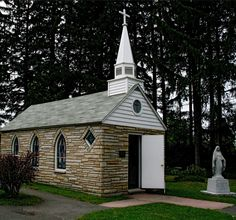 """""""Our Lady Of The Pines"""" is a small, well-kept Roman Catholic church in Horse Shoe Run, West Virginia. It has been promoted on old vellum postcards as the """"Smallest Church in 48 States."""" Even today, a sign makes this odd claim to fame (Alaska and Hawaii became the 49th and 50th states in 1959). The building measures 24 ft. X 12 ft. and seats 12 people."""