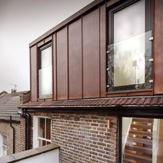 Copper-clad roof extension to east london flat by Poulsom Middlehurst