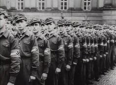 Hitler Youth battalion on parade to wish farewell to senior Youth members who have joined the SS and are departing for the Eastern Front, winter 1943.