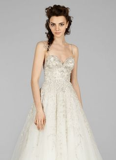 Ivory beaded and embroidered tulle A-line bridal gown , sweetheart neckline  with jeweled straps, natural waist, skirt accented with floral embroidery,  chapel train.  IVORY  SIZE 12 SAMPLE IN IVORY IS AVAILABLE