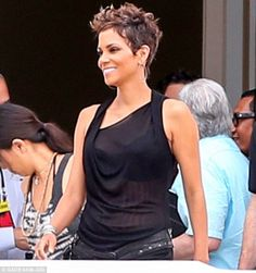 Halle Berry displays her blossoming figure in a sheer top as she ...