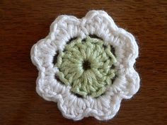 Crochet flower tutorial #crochet @Alyssa Senseney  I would stick with one color in variegated yarn.  just another possibility.  i would also encourage you to keep it by your couch so you can put a cartoon on for the boys and do a flower.  the more you make the faster you will be.