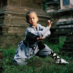 Hao Han (8), Shaolin kung fu student and child actor. Shaolin Monastery, Henan. (Photo by Mathias Braschler and Monika Fischer)