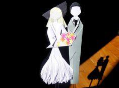 Topo de bolo ALINE.    Realizado para a cliente Aline do Rio de Janeiro - RJ.    Valor referente ao casal.    Medidas aproximadas do noivo (sem contar com o palito): 14,5x2,5cm.  Medidas aproximadas da noiva (sem o palito, véu e os sapatos): 13,5x5,5 cm.  Peso aproximado com embalagem: 10g.    Design original de Sayuri Murakami (Momô Artesanatos).    Sob encomenda: informe a cor desejada.    Frete à orçar: Carta, PAC ou SEDEX. Envio em caixa ou envelope reforçado.    Obs.: Pode haver pequena…