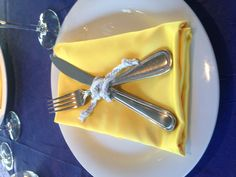Nautical Wedding Setup on Mystic Blue Cruises.  Yellow Napkins, Blue Tablcloths and Rope Ties.