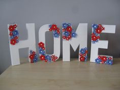 Hand Painted 'Home' Letters decorated with Hand Crafted Clay flowers
