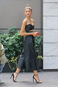 Zendaya takes streetstyle to new levels in crop top and culotte pants. #streetstyle #style #blogs #fashion