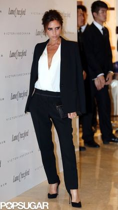 Victoria Beckham in masculine black suit with sexy deep V top @ the Lane Crawford department store in Beijing