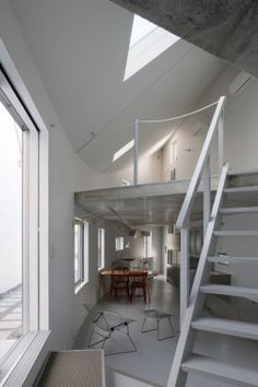 Y House is a minimalist house located in Hiroshima, Japan, designed by Hideyuki Nakayama Architects. The home is two-storys with one side that is completely grey and practically windowless, and the other a curved, white wall that matches the color of the adjacent building. (1)