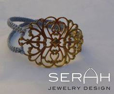 Fashionable bracelet with ornamental centerpiece by serahgaon