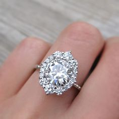 Forever One™ or Supernova™ Moissanite Engagement Ring with Diamond Halo (2.55ct)